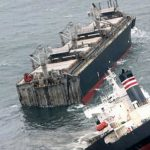 Battle to contain oil spill from wrecked Japanese bulker